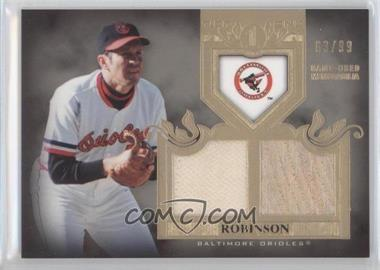 2011 Topps Tier One Top Shelf Relics Dual #TSR45 - Brooks Robinson/99 - Courtesy of COMC.com